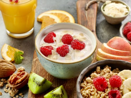 Photo for Bowl of yogurt with raspberries for healthy breakfast - Royalty Free Image