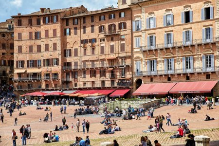 """Photo for Siena, Italy - MAY 4, 2017: View of """"Piazza del Campo"""" main square in the city center of Siena, famous for its horse race and parade called """"Palio di Siena"""". Located in the Tuscany region - Royalty Free Image"""