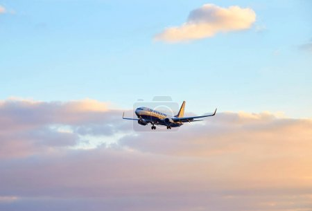 Ryanair airplane flying at sunset