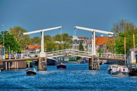 Boat passing under Gravestenenbrug bridge in Haarlem, Netherland