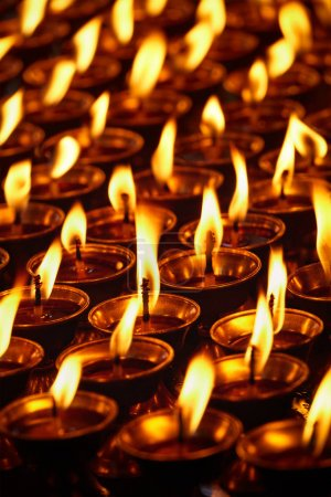 Photo for Burning candles in Buddhist temple. Dharamsala, Himachal Pradesh, India - Royalty Free Image