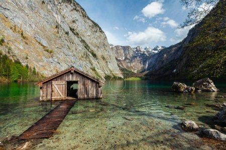 Boat shed on Obersee lake. Bavaria, Germany