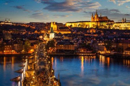 Night view of Prague castle and Charles Bridge over Vltava river