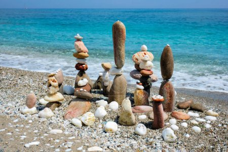 Photo for Concept of zen balance relaxation peace and harmony. Pebbles stacks on the beach coast of the blue sea in the nature. Meditative art of stone stacking. - Royalty Free Image