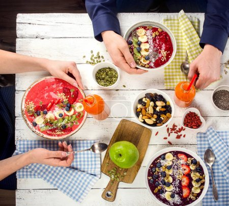 Photo for Family Breakfast with berries smoothies and superfoods. Healthy eating concept. Top view - Royalty Free Image