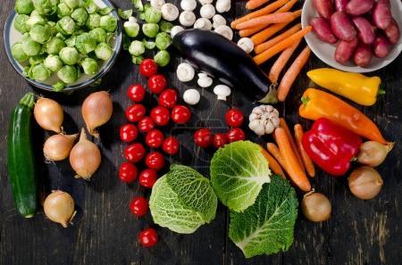 Vegetables on dark wooden board
