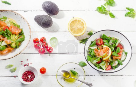 Photo for Fresh Salmon salad with cherry tomatoes and olive oil with avocados on wooden table. Healthy diet eating concept - Royalty Free Image