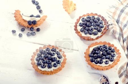 sweet tarts with fresh blueberries