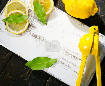 Squeezer and lemons on board