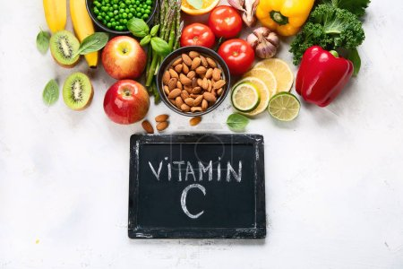 Photo for Foods high in vitamin C. Food rish in antioxidant, fiber, carbohydrates. Boost immune system and brain; balances cholesterol; promotes healthy heart.Top view with copy space - Royalty Free Image