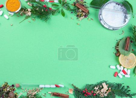 Photo pour Médecine alternative à base de plantes. Herbal medicine and homeopathy concept.Top view, flat lay on color background - image libre de droit