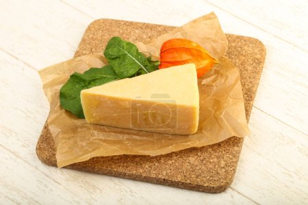 Tasty Parmesan cheese slice with salad leaves over...
