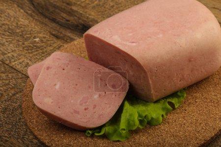 Ham over salad leaves