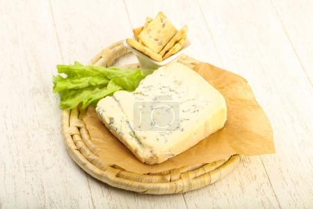 Gorgonzola cheese slice with salad leaves over the...
