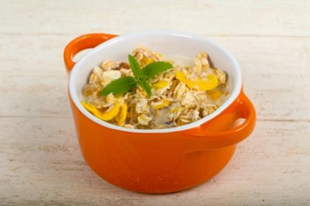 Muesli with banana, nuts and mint leaves