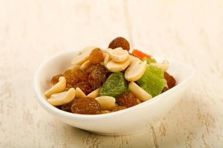 Photo for Nut and dry fruit mix over wooden background - Royalty Free Image