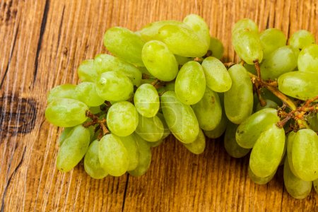 Ripe sweet Green Grape over the wooden background