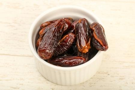 Sweet dates fruit heap in the bowl