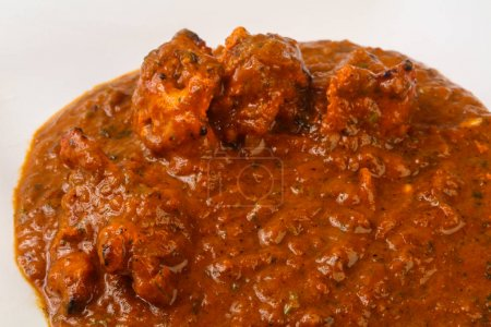 Indian traditional cuisine - Masala chicken with spices