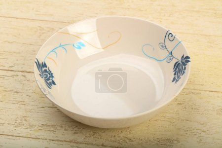 Empty plate for home or restaurant over wooden background