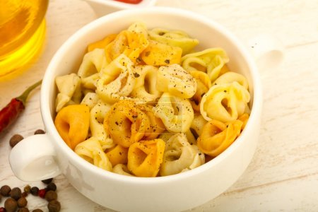Ravioli pasta served olive oil and pepper