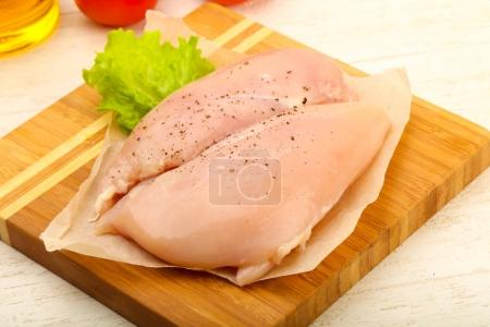 Raw chicken breast with pepper ready for cooking
