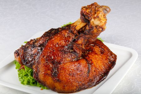 Baked Pork leg in white plate