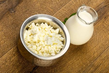 Cottage cheese in the bowl with milk