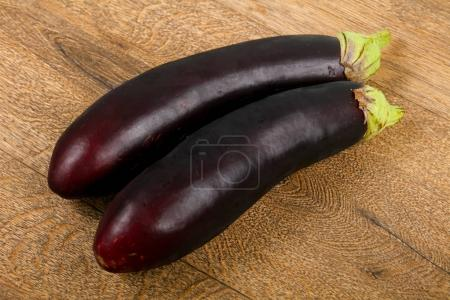 Two Eggplants on the wooden background