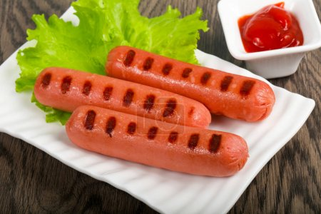 Photo for Grilled sausages with salad and ketchup - Royalty Free Image