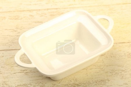 Empty plate for home or restorant over wooden background