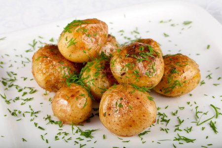 Photo for Young baked potato with dill - Royalty Free Image
