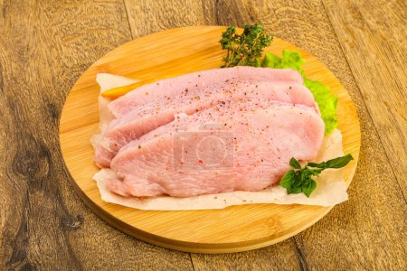 Photo for Raw turkey steak with spices ready for grill - Royalty Free Image