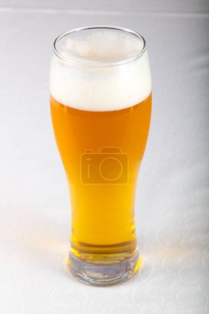 Cold Beer glass on white table