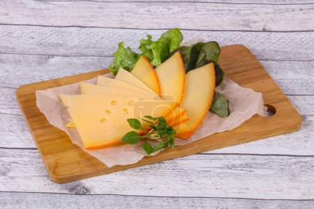 Photo for Sliced yellow Swiss cheese served salad leaves - Royalty Free Image