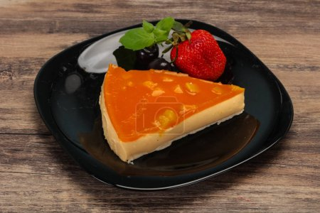 Photo for Cheesecake with apricot served strawberry and mint - Royalty Free Image