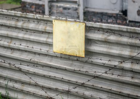 signboard on fence with wire in Chernobyl