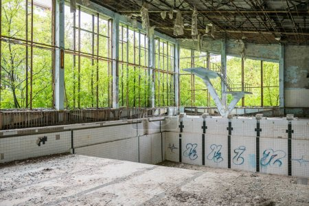 Photo for Abandoned swimming pool in Sports Palace gym in Pripyat - Royalty Free Image