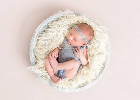 baby in gray suit sleeping, moving, topview