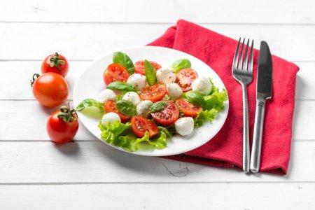salad served for vegeterians, silverware