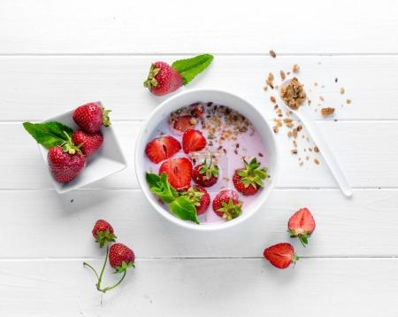 Fitness foods with granola and nuts, topview