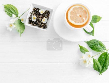 jasmine green steaming tea, flowers, textspace, topview