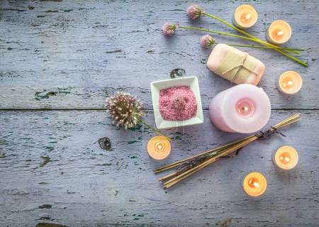 Scented candles, homemade soap, weathered paint, topview