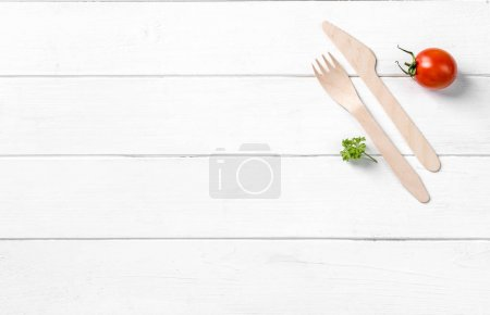 Organic food, wooden knife, text space left