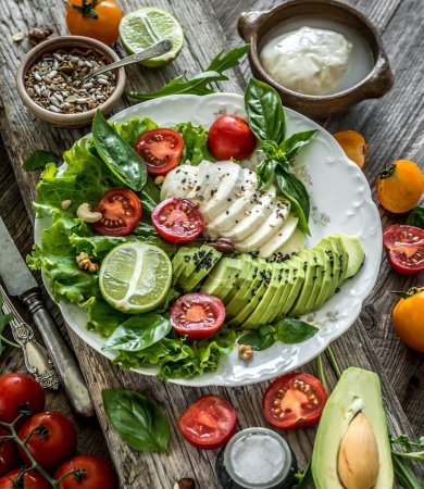 Photo for Vegetarian salad with mozzarella, avocado and tomatoes - Royalty Free Image