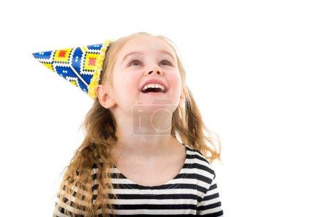Child girl in birthday cone hat
