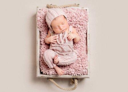 Gorgeous newborn baby sleeping, top view