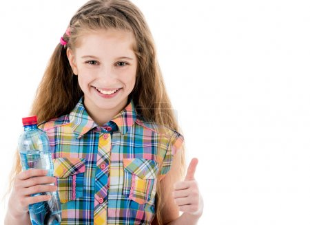 Little girl with bottle of water showing ok sign