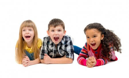 three funny children lying on the floor with open mouths