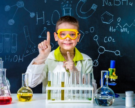 Photo for Schoolboy in chemistry lab got an idea practising experiments - Royalty Free Image